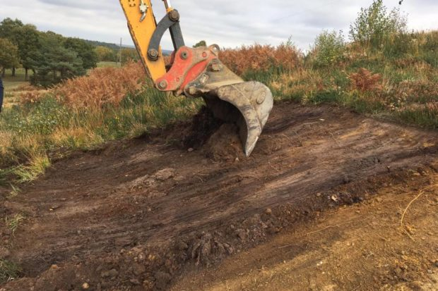 JCB carrying out heathland restoration work at Tweseldown Racecourse