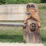 Carved bench at Bramshot Farm Country Park by Hart Countryside team
