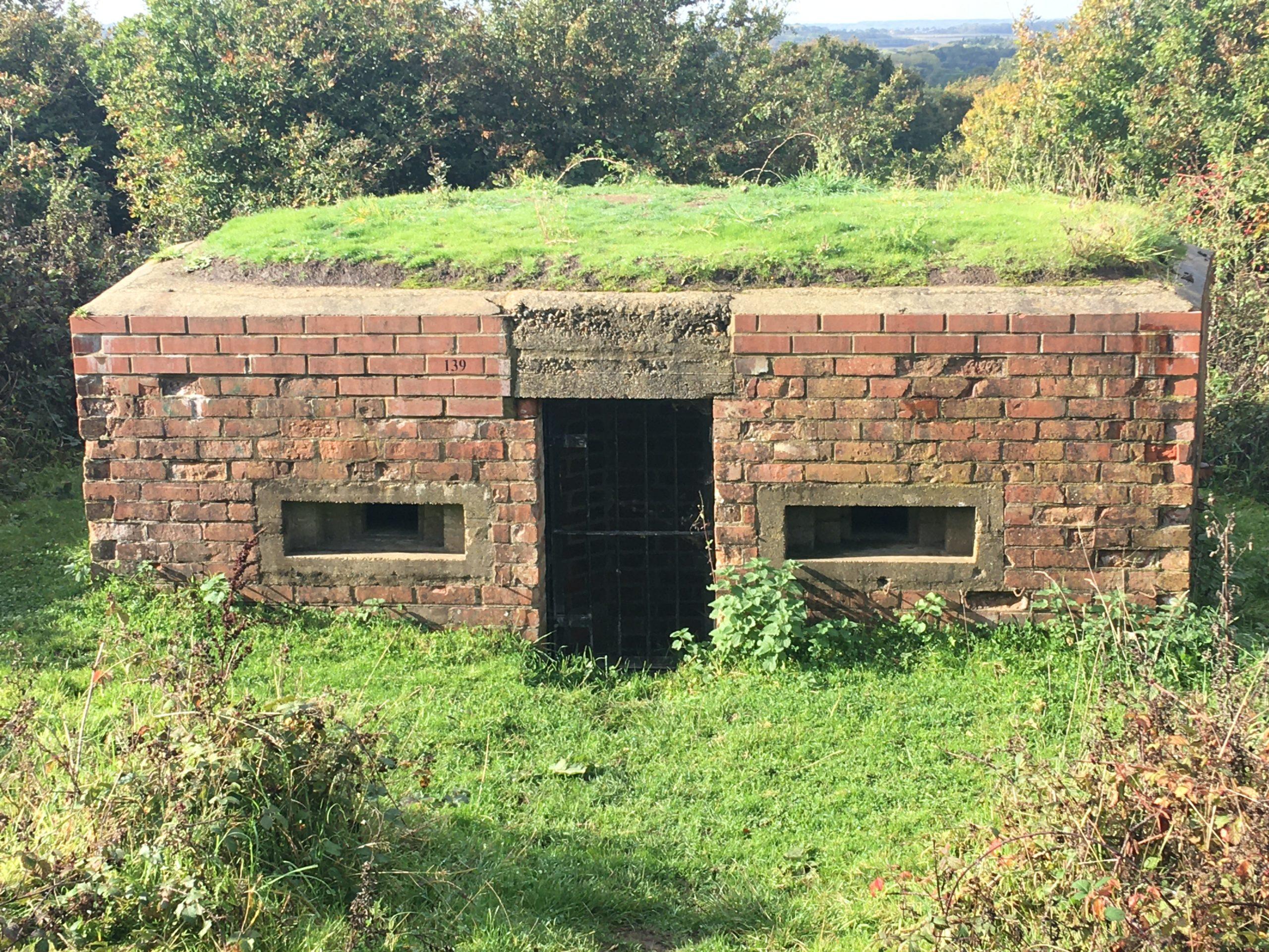 Photograph of a pillbox at Naishes Wood