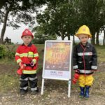 Photograph of two young boys dressed as fire fighters!